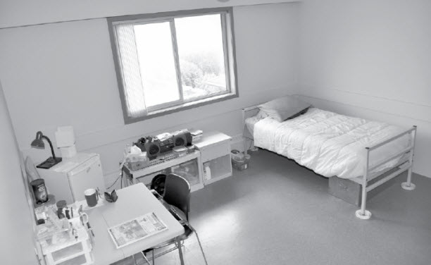 Bedroom in a Community Correctional Centre. Description follows.