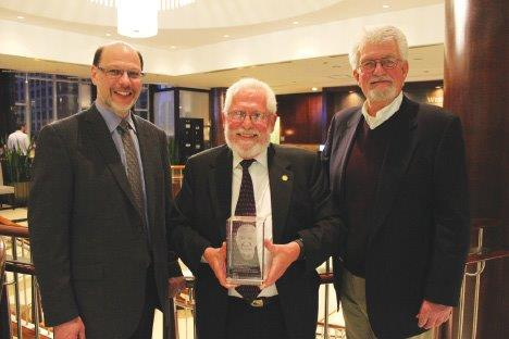 A photo of the 2015 recipient (John W.Conroy) of the Ed McIsaac Human Rights in Corrections Award.  Description follows.