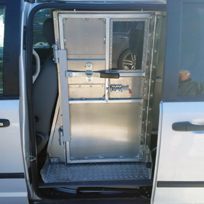 Photo of metal door of inmate transport van.