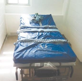 Photo of a bed used as part of the Pinel restraint system