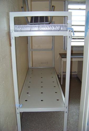 A picture of a bunk bed (without a ladder) used when inmates are double bunked.