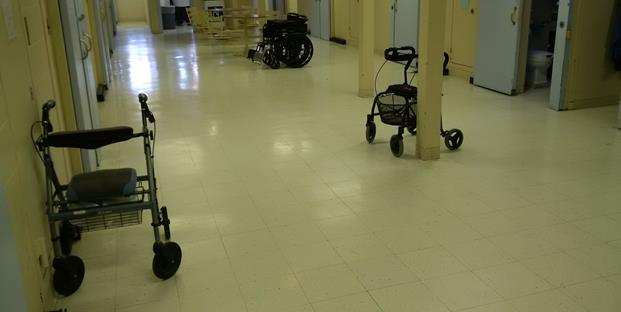 This is a picture of a wheelchair and two walkers on a range designated for older offenders.