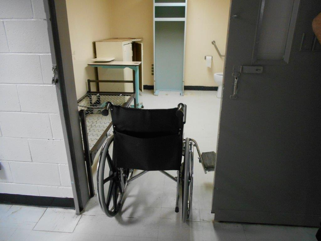 This is a picture of a wheelchair in the doorway of an accessible cell.